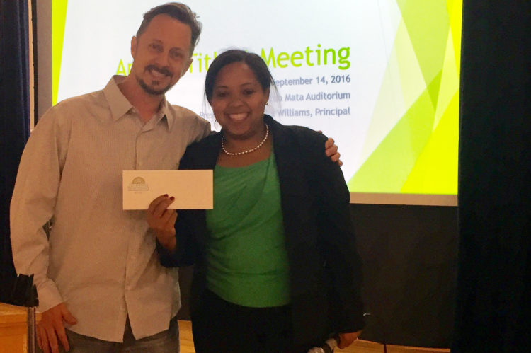 Hollywood Santa Monica Neighborhood Association President (and Mata dad), Jarrett Stampes, presents Mrs. Williams a check for $2,612 at the PTA meeting.